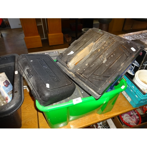46 - Green plastic box containing 2x table top electric saws not tested, plus a dremel not tested sold as...