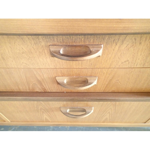 701 - Teak G Plan type sideboard with cupboard, three drawers and pull-down section L: 210 cm...