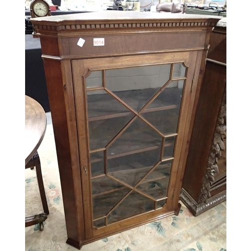 736 - Corner glass fronted cabinet on base in mahogany H: 115 cm...