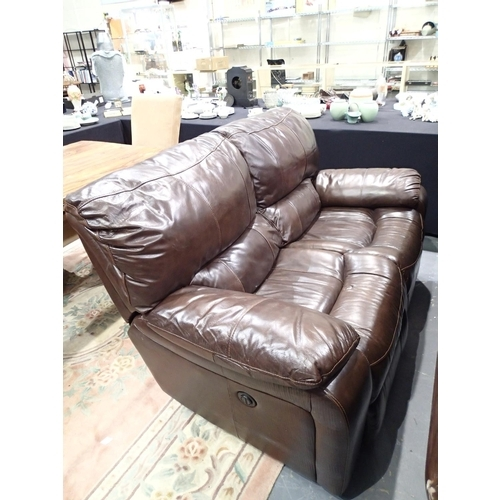 746 - Two seater brown leather double recliner settee...