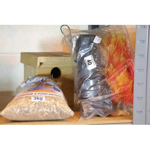 40 - Aquarium internal filter, bag of gravel, plastic faux plants and a wooden bird nesting box. This lot...