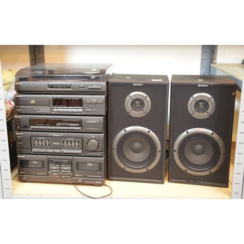 50 - Sony stack HiFi system, two speakers, CDs and cassettes etc. This lot is not available for in-house ...
