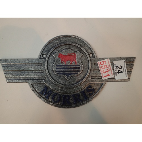 24 - Cast iron metal Morris motors sign L: 27cm. P&P Group 2 (£18+VAT for the first lot and £2+VAT for su...