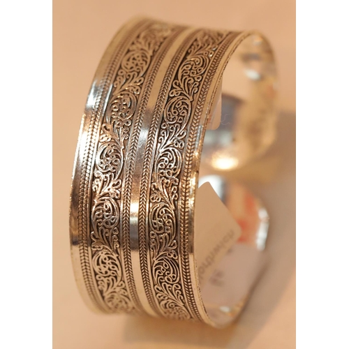 33 - White metal ethnic type cuff bangle, D: 7 cm. P&P Group 1 (£14+VAT for the first lot and £1+VAT for ...