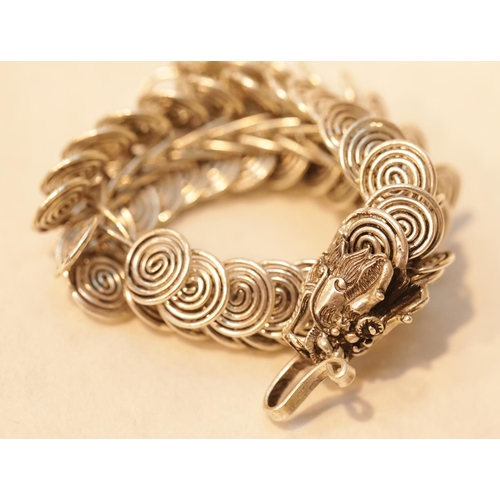 39 - White metal Tibetan silver linked dragon bracelet, L: 20 cm. P&P Group 1 (£14+VAT for the first lot ...