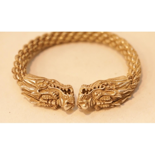 40 - White metal Tibetan silver dragon bangle, D: 9.5 cm. P&P Group 1 (£14+VAT for the first lot and £1+V...