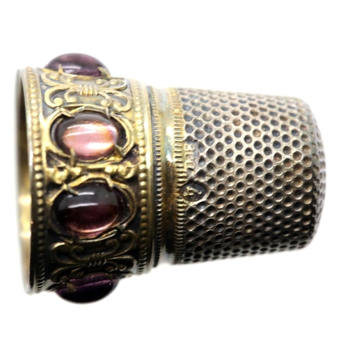 1020 - Continental 800 silver thimble, surmounted with six purple glass cabochons, size 4, 5g. P&P Group 1 ...