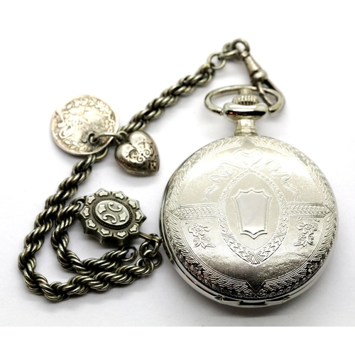 1034 - White metal pocket watch and chain, dial D: 3 mm, chain L: 19 cm, 49g. Working at lotting. P&P Group...