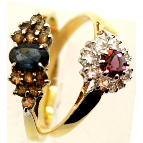 57 - Two yellow metal stone set dress rings, 3.5g total. P&P Group 1 (£14+VAT for the first lot and £1+VA...
