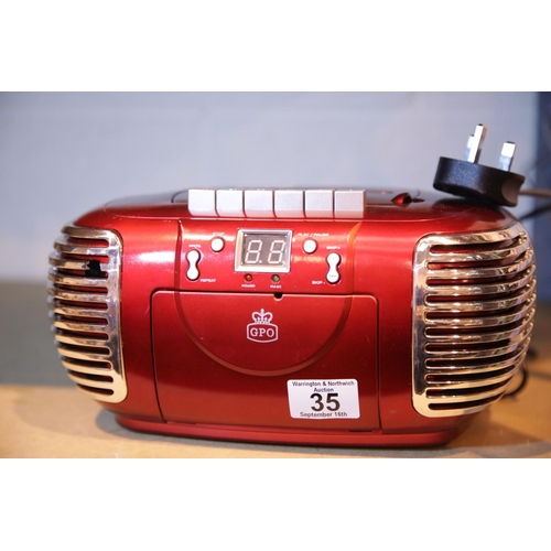35 - Red GPO PCD299 a 3-in-1 FM/AM Radio, CD and Cassette player with power cable. Not available for in-h...