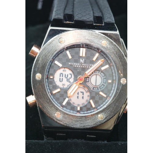 58 - Boxed Michael Philippe mens wristwatch with black dial on black rubber strap. P&P Group 1 (£14+VAT f...