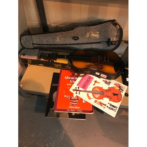 54 - Child's violin with three lesson books. Not available for in-house P&P...