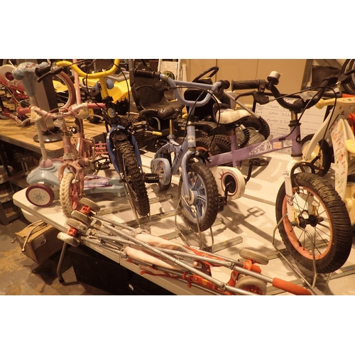 24 - Four children's bikes, folding pram and three wheeled scooter. Not available for in-house P&P...