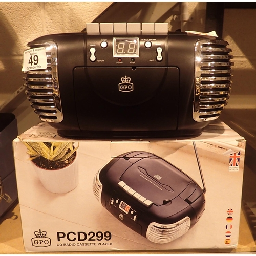 49 - Black 3-in-1 FM/AM radio, CD and cassette player, boxed, GPOPCD299. Not available for in-house P&P C...