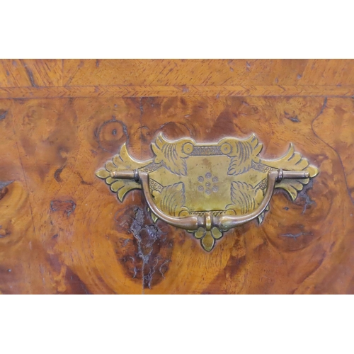 443 - An early 19th Century walnut chest on chest fitted with nine drawers and slide, raised on bracket su...