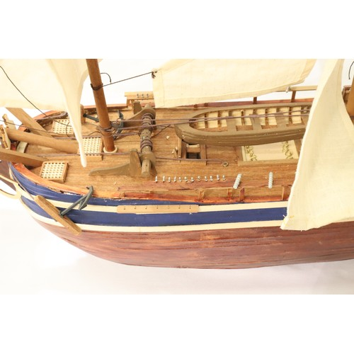 2485 - Wooden static kit built model of HMS Bounty with cutaway hull showing below decks, L: 90 cm. Not ava...