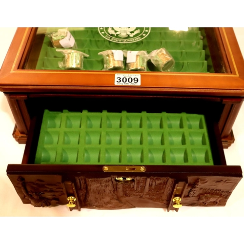 3009 - The Danbury Mint part-filled Never Circulated US State Quarters collection with glazed display case,...