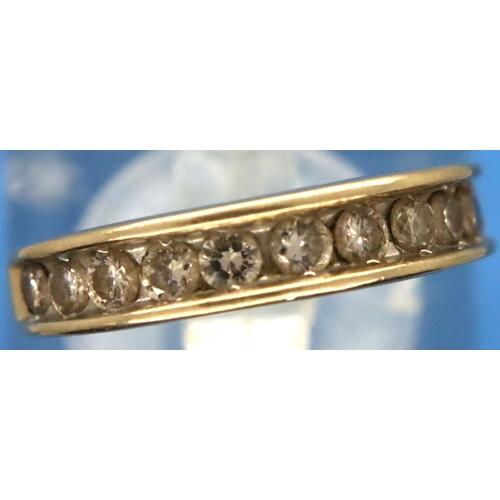 32 - 9ct gold channel set diamond set half eternity ring, size K/L, 2.3g. P&P Group 1 (£14+VAT for the fi...