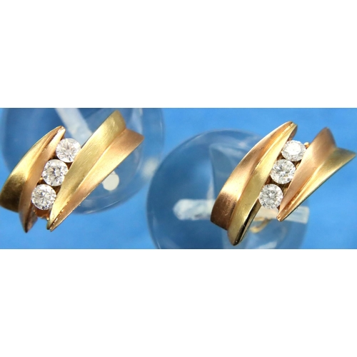 34 - 14ct rose and yellow gold earrings, each set with three diamonds, combined 5.5g, used with no damage...
