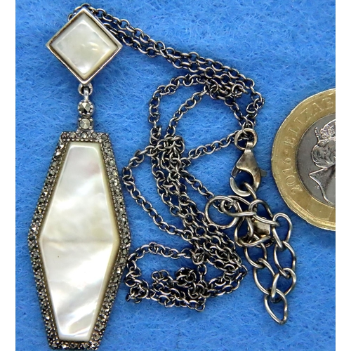 41 - Mother of pearl and marcasite pendant on a silver chain. P&P Group 1 (£14+VAT for the first lot and ...
