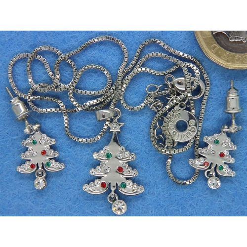 57 - Collection of white metal jewellery including pendants and earrings. P&P Group 1 (£14+VAT for the fi...