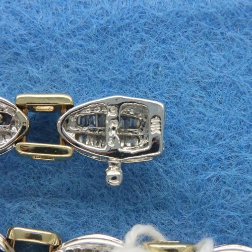 14 - 14ct white and yellow gold bracelet set with baguette cut diamonds, L: 18 cm, 18.4g. Good condition,...
