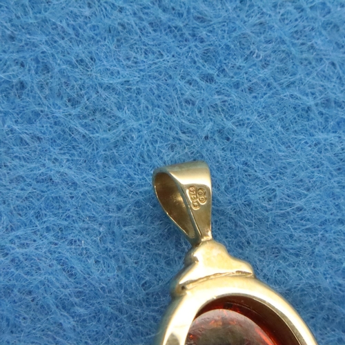 3 - 9ct gold amber set pin brooch, stone L: 18 mm, 2.9g. P&P Group 1 (£14+VAT for the first lot and £1+V...