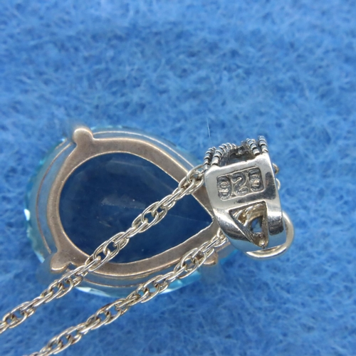 38 - Large blue topaz and marcasite pendant on a silver chain. P&P Group 1 (£14+VAT for the first lot and...