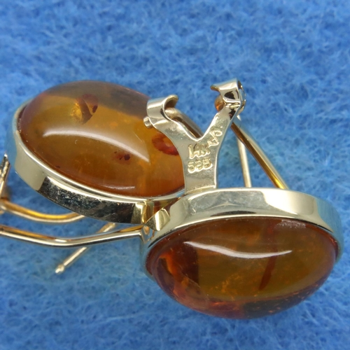 40 - Pair of 14ct gold amber set earrings, L: 15 mm, 5.2g. P&P Group 1 (£14+VAT for the first lot and £1+...