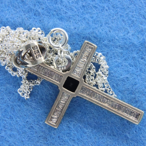 51 - Garnet and marcasite cross on a silver chain. P&P Group 1 (£14+VAT for the first lot and £1+VAT for ...