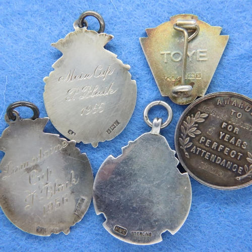 52 - Five silver fob medals including an Old Bury Urban District Education Committee example, combined 47...