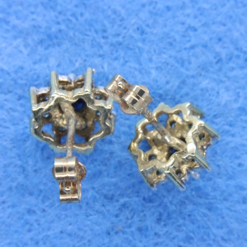 54 - Pair of 9ct gold earrings set with sapphires and diamonds, combined 1.7g. Both butterfly backs prese...