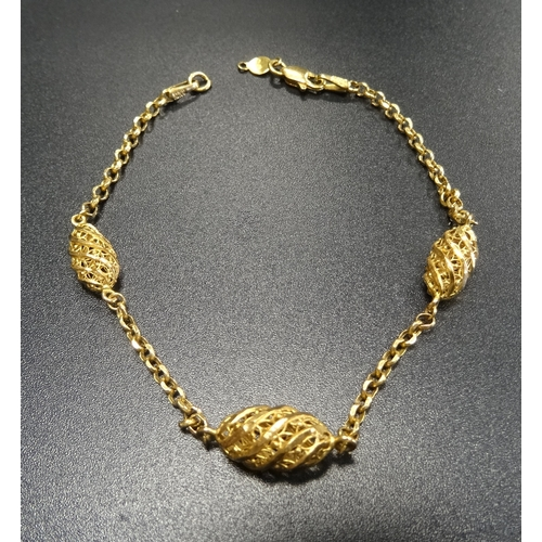 8 - TWENTY-ONE CARAT GOLD BRACELET with three pierced elliptical links separated by chain sections, tota...
