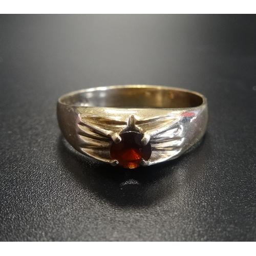 9 - GARNET SET NINE CARAT GOLD RING ring size V-W...