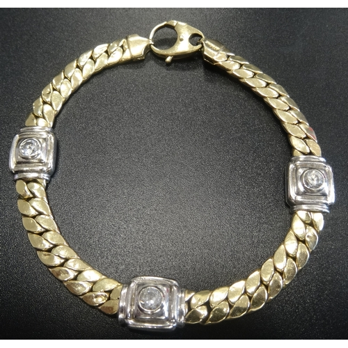 13 - FOURTEEN CARAT TWO TONE GOLD BRACELET with three CZ set square links in white gold separated by yell...
