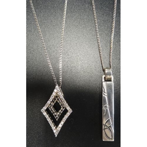 19 - TWO SILVER PENDANTS one of diamond shape set with marcasite and CZ, the other with motif decoration,...