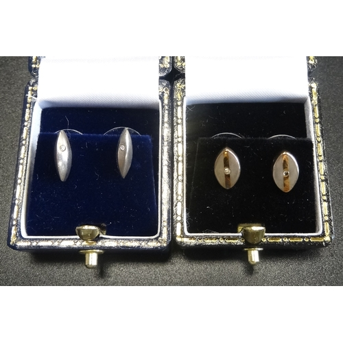 20 - TWO PAIRS OF DIAMOND SET STUD EARRINGS both in silver and with boxes (2 pairs)  -  RETURNED...