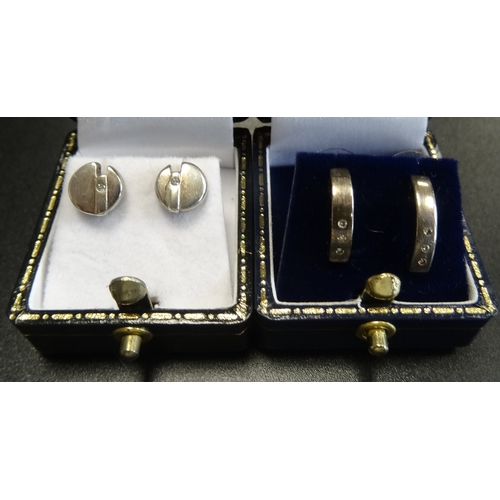 31 - TWO PAIRS OF DIAMOND SET STUD EARRINGS in silver  -  RETURNED...