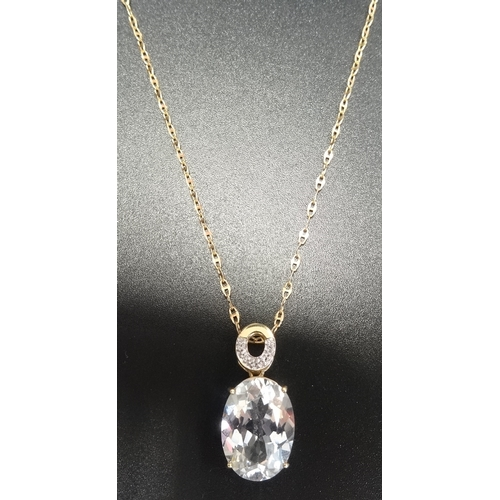 34 - DIAMOND AND GEM SET PENDANT the oval cut gemstone (possibly topaz) below smaller diamonds, in nine c...