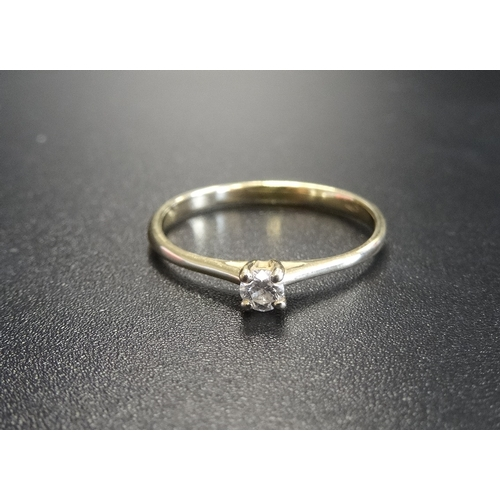 37 - DELICATE DIAMOND SOLITAIRE RING on fourteen carat gold shank, ring size J-K...