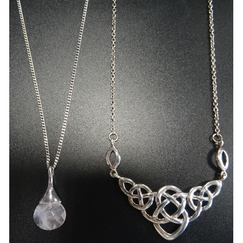 40 - HERITAGE BY KIT HEATH SILVER PENDANT of Celtic knot design, on attached silver chain; together with ...