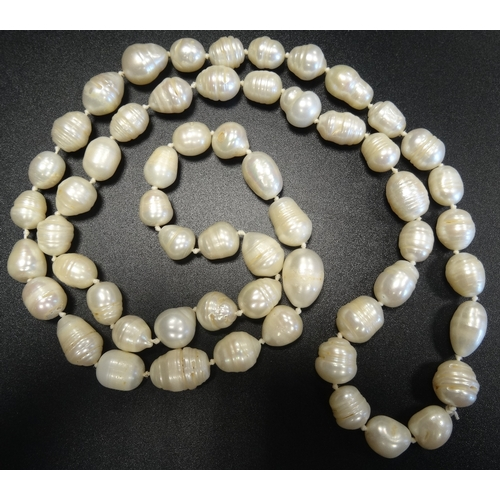 48 - BAROQUE PEARL NECKLACE approximately 82cm long...