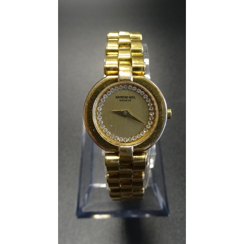 99 - LADIES RAYMOND WEIL GOLD PLATED WRISTWATCH the gilt dial set with diamonds, on gold plated bracelet ...
