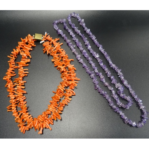 101 - TWO BEAD NECKLACES comprising an amethyst example and a double strand coral necklace (2)...