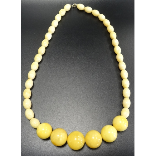 126 - UNUSUAL YELLOW AMBER BEAD NECKLACE the front section with six larger round beads flanked by smaller ...