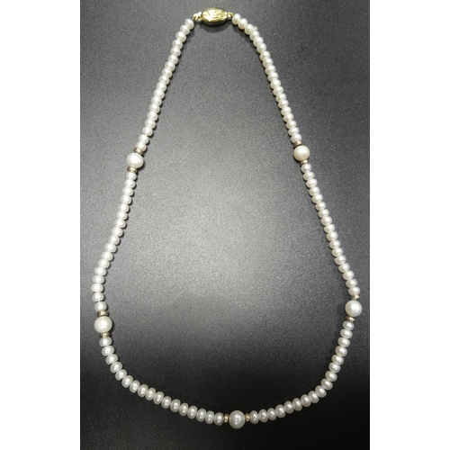 133 - PEARL NECKLACE  the small pearls interspersed with larger pearls and gold spacers, with nine carat g...