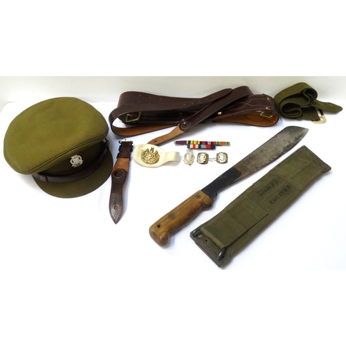 330 - ROYAL ARMY ORDNANCE CORPS INTEREST including an officers hat, three RAOC badges, a Sam Browne belt, ...