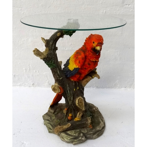 396 - CIRCULAR GLASS TOP OCCASIONAL TABLE raised on a resin base modelled as a colourful Macaw on a natura...