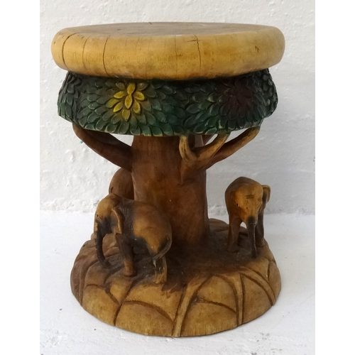 398 - CARVED ELM STOOL with a circular seat and frieze carved to represent a tree and its canopy, with thr...