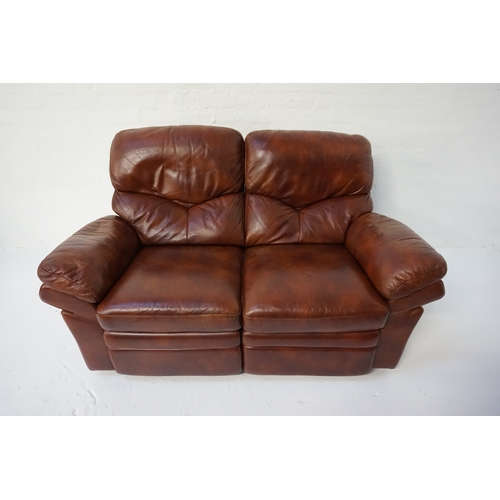 404 - BROWN LEATHER TWO SEATER RECLINING SETTEE raised on small feet, 164cm wide...